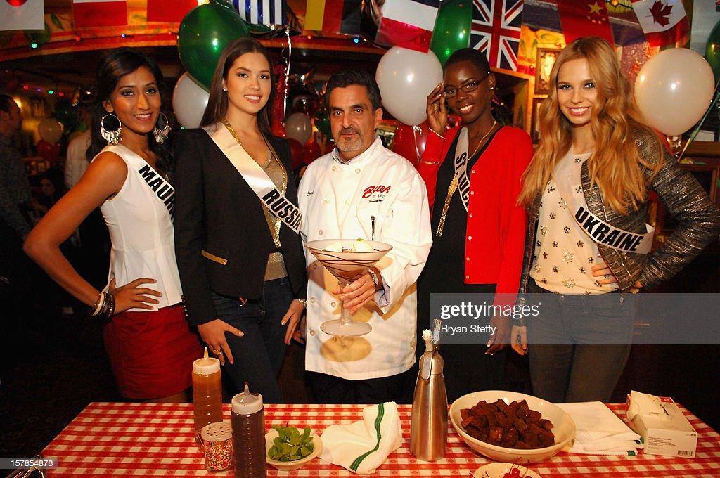 Miss Mauritius Ameeksha Devi Dilchand, Miss Russia Elizaveta Golovanova, Chef Stuart Leitner, Miss St Lucia Tara Edward and Miss Ukrane Anastasia Chernova appear at the Buca di Beppo Italian Restaurant on December 6, 2012 in Las Vegas, Nevada.