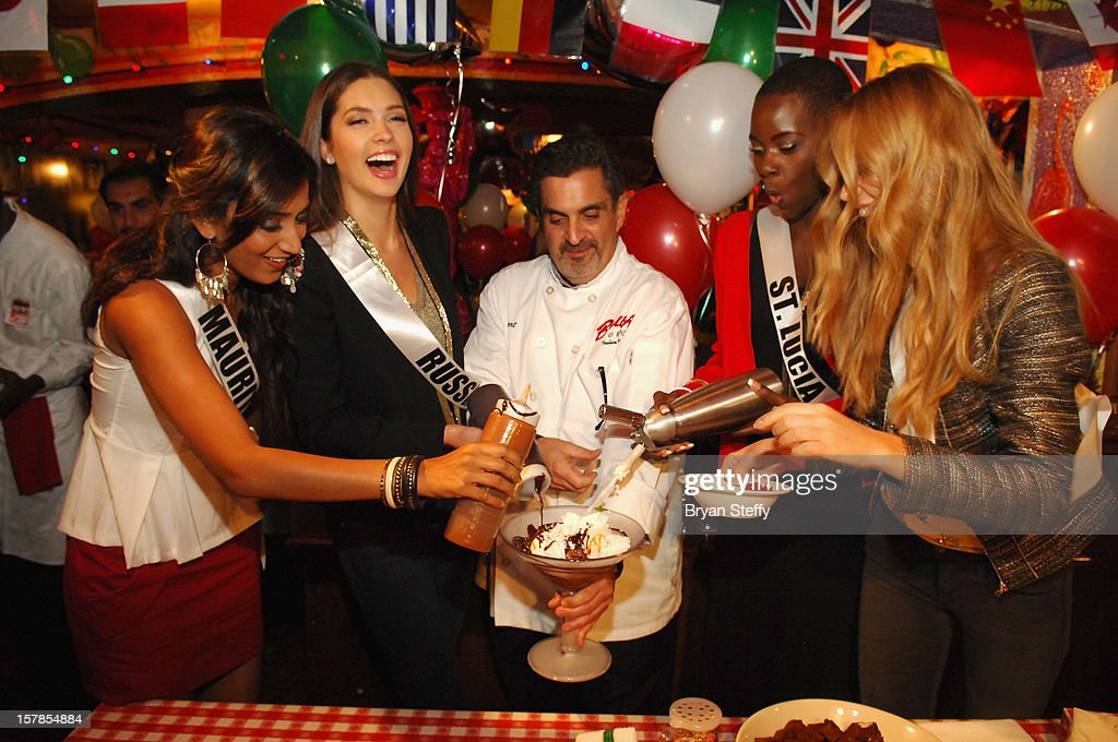 Miss Mauritius Ameeksha Devi Dilchand, Miss Russia Elizaveta Golovanova, Chef Stuart Leitner, Miss St Lucia Tara Edward and Miss Ukrane Anastasia Chernova appear at the Buca di Beppo Italian Restaurant on December 6, 2012 in Las Vegas, Nevada.