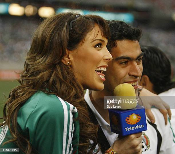 Miss Mexico 2000 Jacqueline Bracamontes interviews players on the sidelines Honduras defeated Cuba 50 during the CONCACAF Gold Cup 2007 match between...