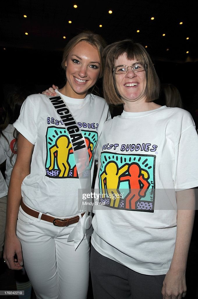 Miss Michigan USA Jaclyn Schultz and a member of the Best Buddies organization appear during a sock hop at Planet Hollywood Resort & Casino on June 9, 2013 in Las Vegas, Nevada.