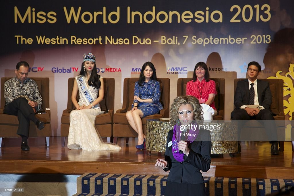 Miss Netherlands answers a question at the opening press conference during the 2013 Miss World Pageant on September 7, 2013 in Denpasar, Bali, Indonesia. The Miss World contest has been protested by conservative Indonesian Muslim groups who object particularly to the Bikini swimwear portion of the competition which organizers have agreed to replace this year with a more modest beachwear competition including tradtional Indonesian batik sarongs.