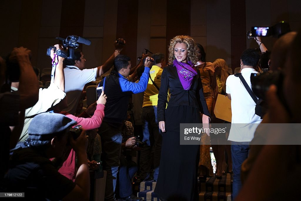 Miss Netherlands arrives at the opening press conference during the 2013 Miss World Pageant on September 7, 2013 in Denpasar, Bali, Indonesia. The Miss World contest has been protested by conservative Indonesian Muslim groups who object particularly to the Bikini swimwear portion of the competition which organizers have agreed to replace this year with a more modest beachwear competition including tradtional Indonesian batik sarongs.