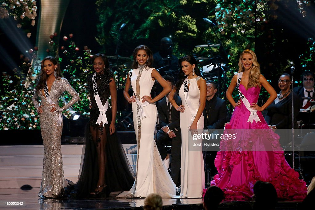 Miss Nevada Brittany McGowan, Miss Maryland Mame Adjei, Miss Rhode Island Anea Garcia, Miss Texas Ylianna Guerra, and Miss Oklahoma Olivia Jordan pose on stage at the 2015 Miss USA Pageant Only On ReelzChannel at The Baton Rouge River Center on July 12, 2015 in Baton Rouge, Louisiana.