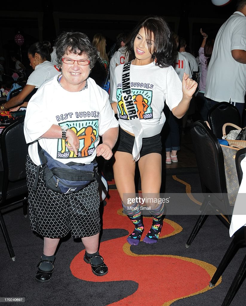 Miss New Hampshire USA Amber Faucher and a member of the Best Buddies organization dance during a sock hop attended by Miss USA 2013 contestants at Planet Hollywood Resort & Casino on June 9, 2013 in Las Vegas, Nevada.