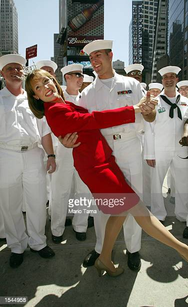 Miss New York Andrea Plummer poses for photographs with US Navy E5 James Lytton from Virginia Beach Virginia in Times Square May 23 2002 in New York...