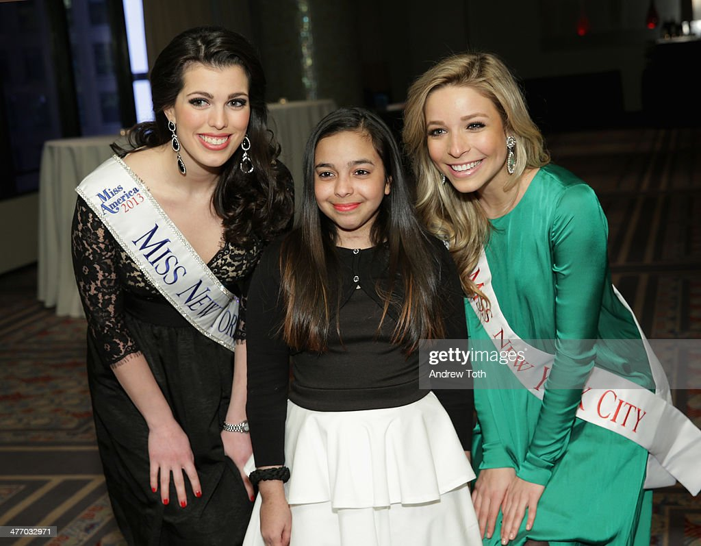 Miss New York City <a gi-track='captionPersonalityLinkClicked' href=/galleries/search?phrase=Kira+Kazantsev&family=editorial&specificpeople=12505447 ng-click='$event.stopPropagation()'>Kira Kazantsev</a> Amanda Mason (L) and a Starlight kid attend the 29th Annual Starlight Children's Foundation at Marriott Marquis Hotel on March 6, 2014 in New York City.