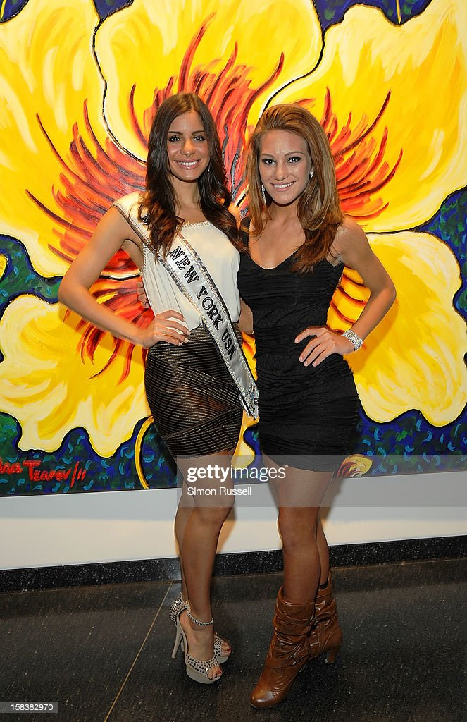 Miss New York USA 2012 Johanna Sambucini and Mis S. Shore Long Island Teen USA April Maroshick attend the Same Sky Holiday Benefit Reception at Ana Tzarev Gallery on December 14, 2012 in New York City.