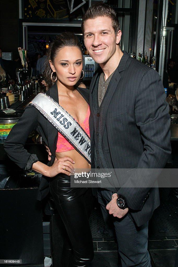 Miss New York USA 2013 Joanne Nosuchinsky (L) and Daniel Koch attend the BlackBook Fashion Week celebration at Toy on February 12, 2013 in New York City.