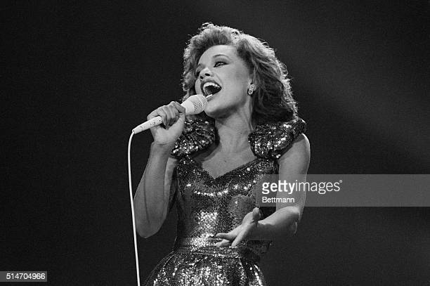 Miss New York Vanessa Williams sings during the talent portion of the 1984 Miss America pageant in Atlantic City Williams won the pageant only to...