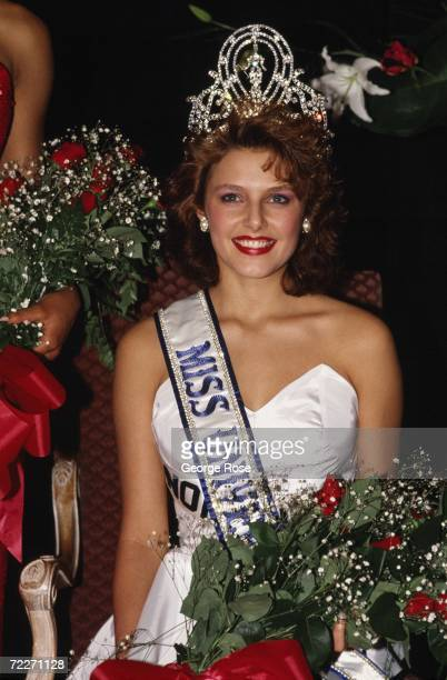 Miss Norway Mona Grudt poses with crown and flower bouquet after she was crowned at the televised 1990 Miss Universe Pageant held at the Century City...
