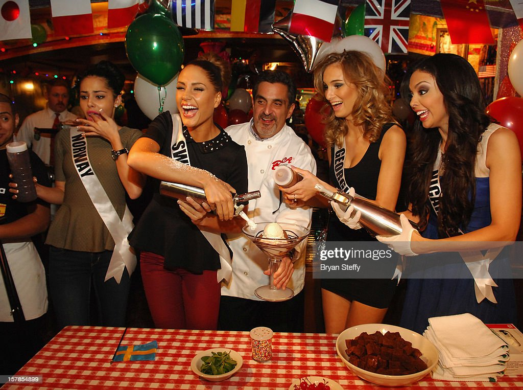 Miss Norway Sara Nicole Andersen, Miss Sweden Hanni Beronius, Chef Stuart Leitner, Miss Georgia Tamar Shedania and Miss Nicaragua Farah Eslaquit appear at the Buca di Beppo Italian Restaurant on December 6, 2012 in Las Vegas, Nevada.