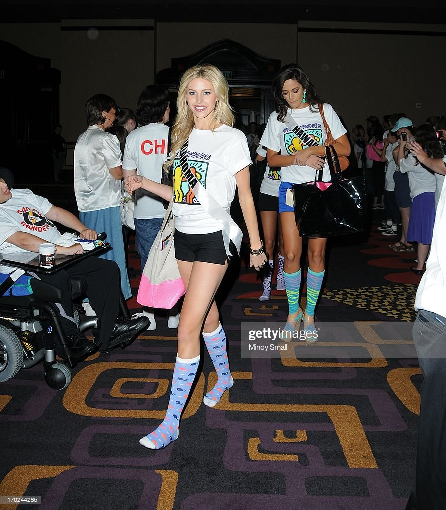 Miss Oklahoma USA Makenzie Muse and members of the Best Buddies organization appear during a sock hop at Planet Hollywood Resort & Casino on June 9, 2013 in Las Vegas, Nevada.