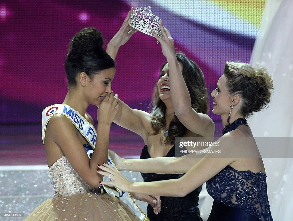 Miss Orleans Flora Coquerel (L) is crowned Miss France 2014 by Miss France 2013 Marine Lorphelin (C) and Miss France Society president Sylvie Tellier (R) during the 67th edition of the beauty contest in the northeastern city of Dijon on December 7, 2013.