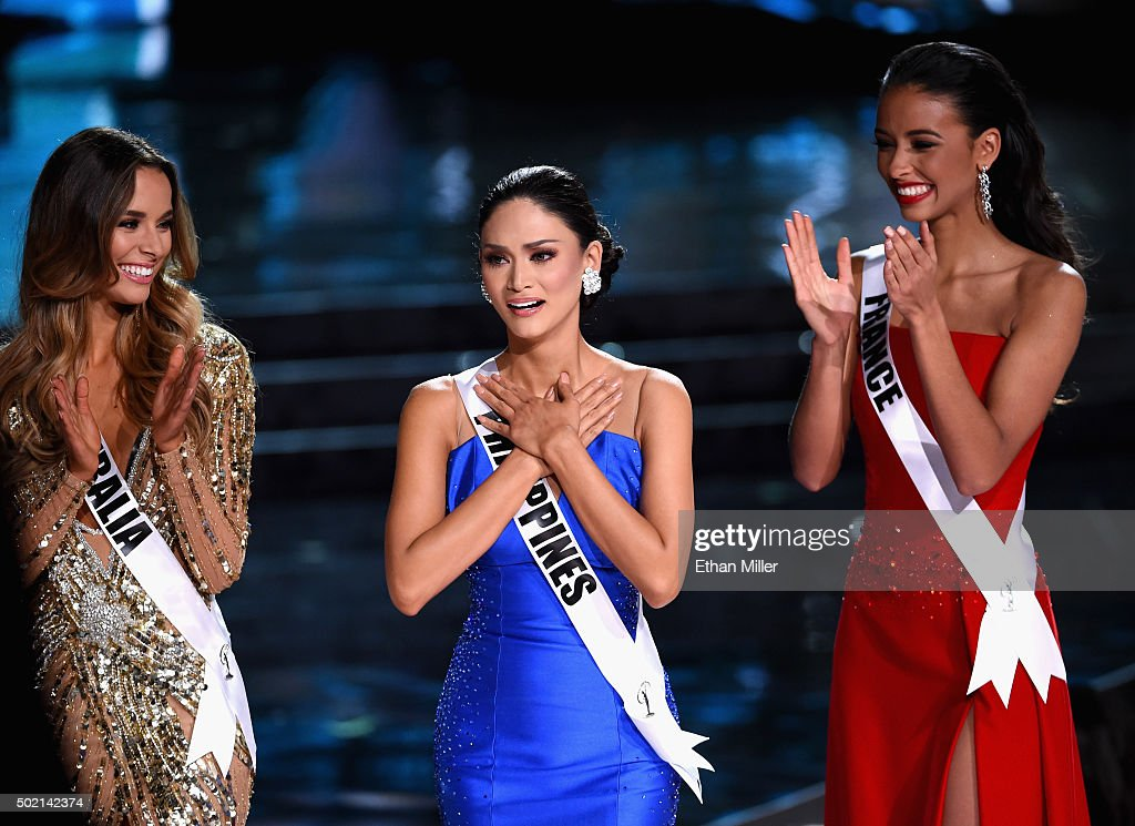Miss Philippines 2015, <a gi-track='captionPersonalityLinkClicked' href=/galleries/search?phrase=Pia+Alonzo+Wurtzbach&family=editorial&specificpeople=15294143 ng-click='$event.stopPropagation()'>Pia Alonzo Wurtzbach</a> (C) reacts as she is named one of the top three finalits as Miss Australia 2015, Monika Radulovic (L), and Miss France 2015, <a gi-track='captionPersonalityLinkClicked' href=/galleries/search?phrase=Flora+Coquerel&family=editorial&specificpeople=11782455 ng-click='$event.stopPropagation()'>Flora Coquerel</a> (R), look on during the 2015 Miss Universe Pageant at The Axis at Planet Hollywood Resort & Casino on December 20, 2015 in Las Vegas, Nevada. Wurtzbach went on to be crowned the new Miss Universe.