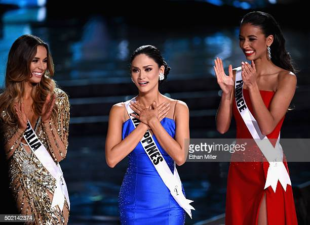Miss Philippines 2015 Pia Alonzo Wurtzbach reacts as she is named one of the top three finalits as Miss Australia 2015 Monika Radulovic and Miss...