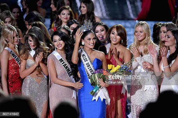 Miss Philippines 2015 Pia Alonzo Wurtzbach who was mistakenly named as first runnerup reacts with other contestants after being named the 2015 Miss...
