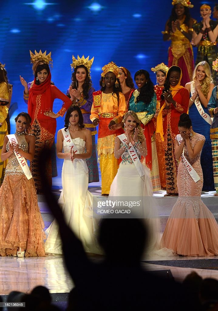 Miss Philippines, Megan Young (4th L) reacts after being announced as the new Miss World while finalists (from L) Miss Gibraltar Maroua Kharbouch, Miss Spain Elena Ibarbia Jimenez and Miss Brazil Sancler Frantz Konzen, applaud after winning the crown over 126 beauty contestants in the Miss World 2013 finals in Nusa Dua, in the Indonesian resort island of Bali on September 28, 2013. Miss Philippines was crowned Miss World 2013 in a glittering finale on the Indonesian resort island of Bali amid tight security following weeks of hardline Muslim protests.