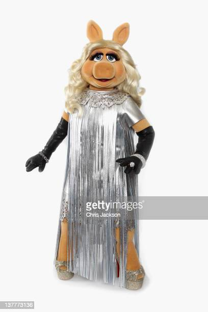 Miss Piggy debuts her dress designed by Giles Deacon for the UK premiere of The Muppets this evening at The Mayfair Hotel on January 26 2012 in...
