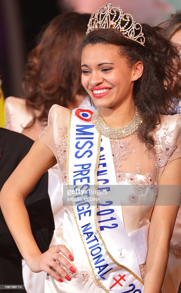 Miss Provence, Auline Grac, crowned Miss Prestige National 2013, poses at the end of the Miss Prestige National 2013 beauty contest, on December 10, 2012 at the Lido cabaret in Paris.