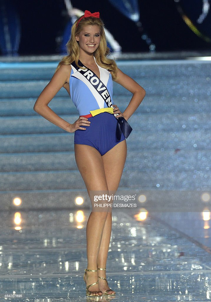 Miss Provence Laetizia Penmellen, third runner-up to Miss Orleans Flora Coquerel crowned Miss France 2014, poses during the 67th edition of the beauty contest in the northeastern city of Dijon on December 7, 2012. AFP PHOTO/PHILIPPE DESMAZES