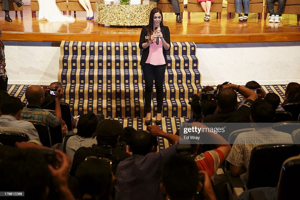 Miss Puerto Rico answers a question at the opening press conference during the 2013 Miss World Pageant on September 7, 2013 in Denpasar, Bali, Indonesia. The Miss World contest has been protested by conservative Indonesian Muslim groups who object particularly to the Bikini swimwear portion of the competition which organizers have agreed to replace this year with a more modest beachwear competition including tradtional Indonesian batik sarongs.