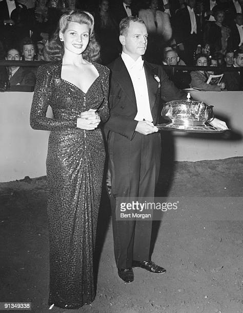 Miss Rita Hayworth with John B Wise who escorted her to the show ring as she made a presentation at The National Horse Show at Madison Square Garden...