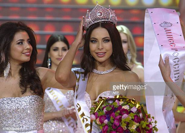 Miss Russia 2014 Yulia Alipova adjusts her crown duringduring the Miss Russia 2014 beauty contest in Moscow early on March 2 2014 23yearold Yulia...