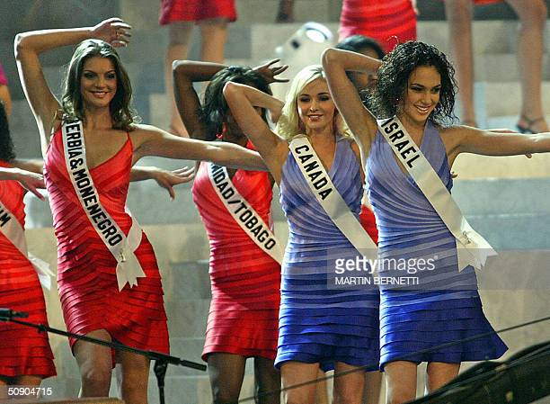 Miss SerbiaMontenegro Dragana Dujovic Miss Canada Vennesa Fisher and Miss Israel Gal Gadot dance on the stage during the first official presentation...