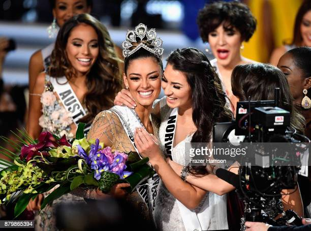 Miss South Africa 2017 DemiLeigh NelPeters embraces Miss Teen USA 2017 Sophia DominguezHeithoff as she is named the 2017 Miss Universe during the...