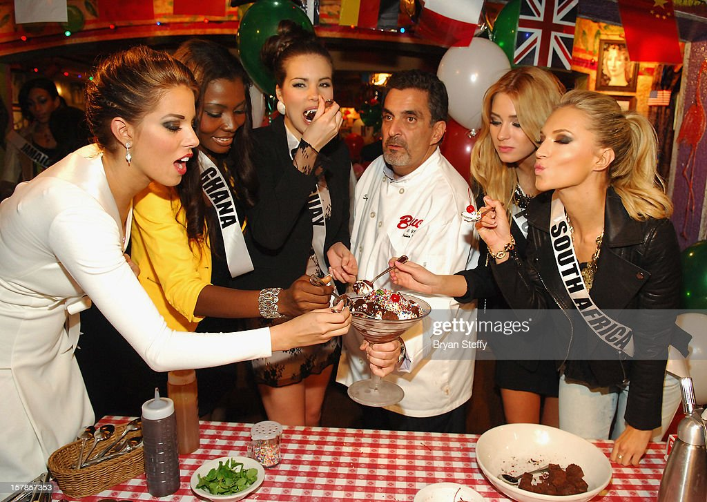 Miss Spain Andrea Huisgen, Miss Ghana Gifty Ofori, Chef Stuart Leitner, Miss Poland Marcellina Zawadzka and Miss South Africa Melinda Bam appear at the Buca di Beppo Italian Restaurant on December 6, 2012 in Las Vegas, Nevada.