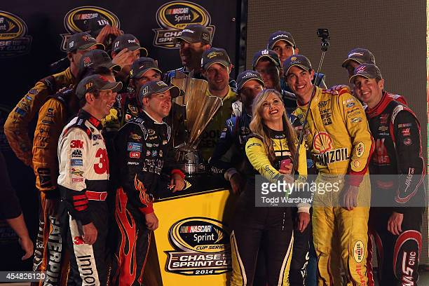 Miss Sprint Cup Kim Coon takes a selfie with Chase for the Sprint Cup qualifiers Jeff Gordon driver of the Drive to End Hunger Chevrolet Kyle Busch...