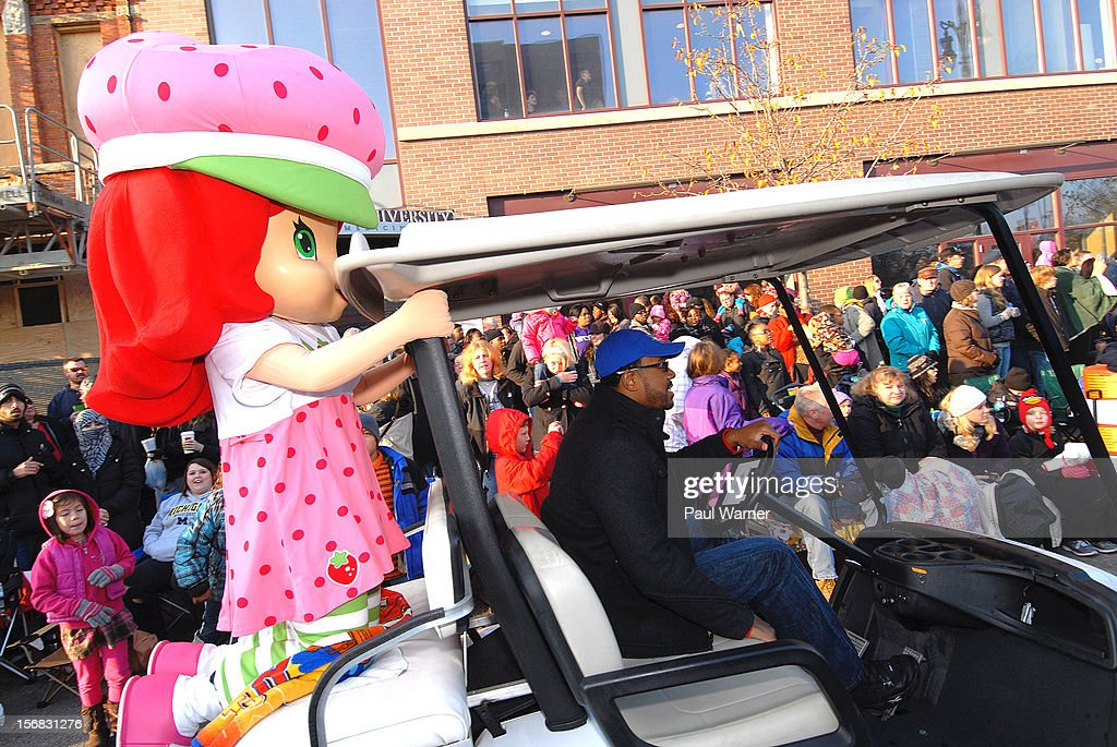 Miss Strawberry Shortcake gets a ride on a golf cart to the staging area at America's Thanksgiving Day Parade at Woodward Avenue on November 22, 2012 in Detroit, Michigan.