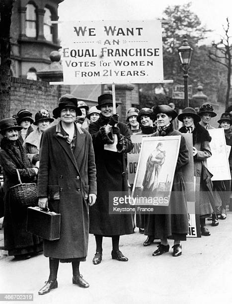 Miss Susan Lawrence left Labour Party Vice President is heading a group of women who ask for the right to vote for Women above 21 circa 1920 in...