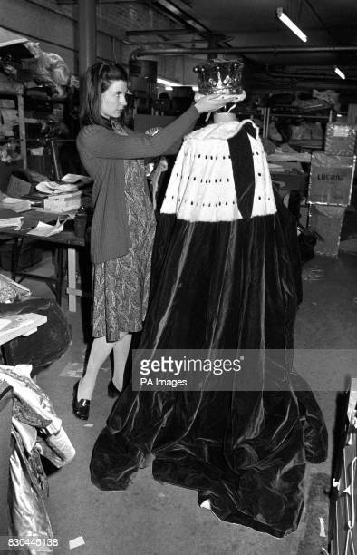 Miss Susan Mayor who runs the costume department at Christie's with Lord Lucan's coronet and robes which come up for auction on May 27th