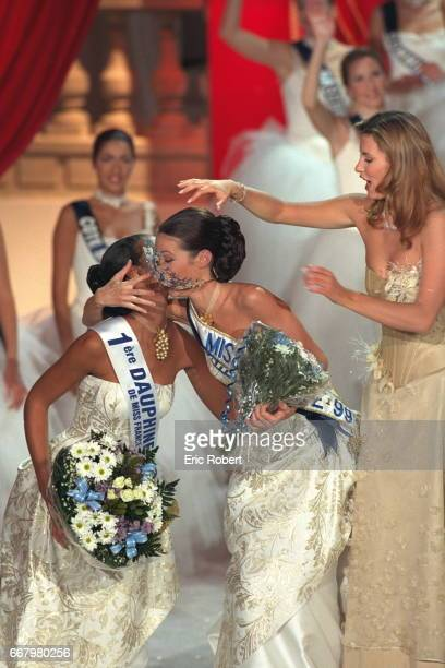 Miss Tahiti now Miss France 1999 kisses Miss Paris who came second with Miss 98 looking on