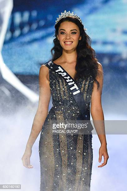 Miss Tahiti Vaea Ferrand appears on stage during the Miss France 2017 beauty contest on December 17 2016 in Montpellier / AFP / Pascal GUYOT