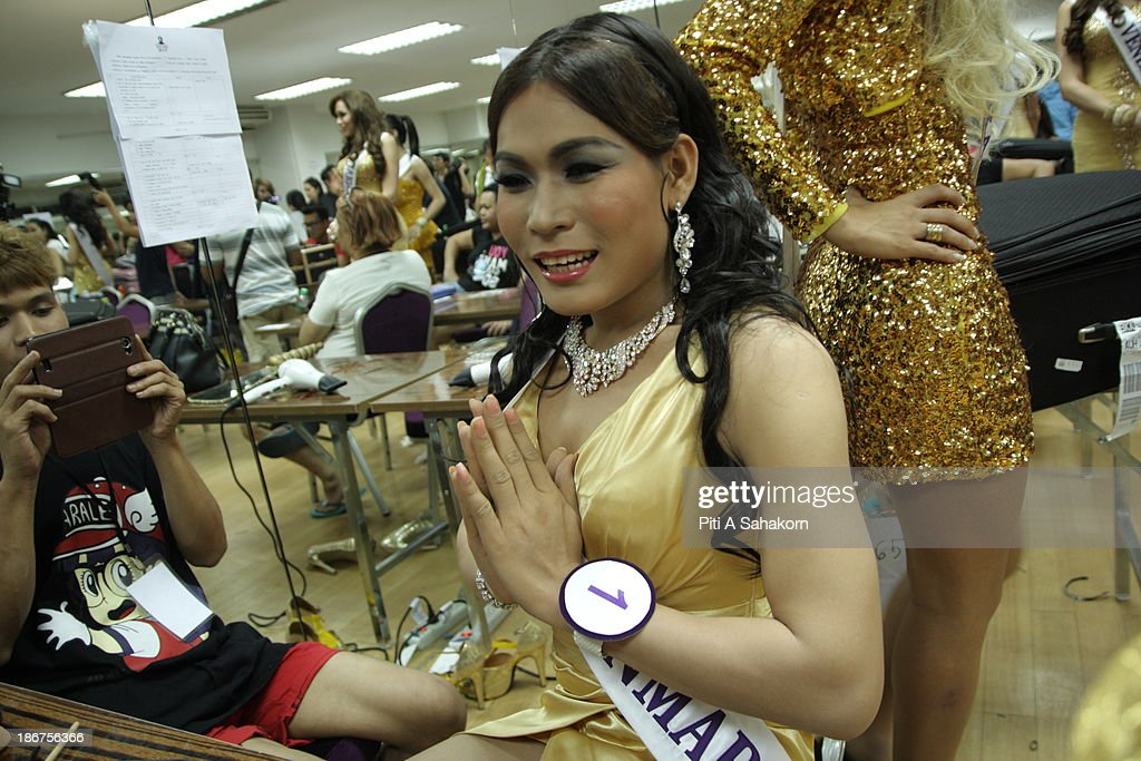 Miss Tanya Maung , (28 years old) from Myanmar makes a traditional Thai greeting gesture while making up backstage for the transvestite and transgender beauty pageant Miss International Queen 2013. Tanya living in Thailand about 1 year and still learning at Ramkhamhaeng university in Bangkok.. Twenty-five contestants from 17 countries are participating in the event, which is endowed with prize money of 300,000 Thai baht (10,000 US dollars), a crown with real gems and a free surgery at a plastic surgery clinic in Bangkok..