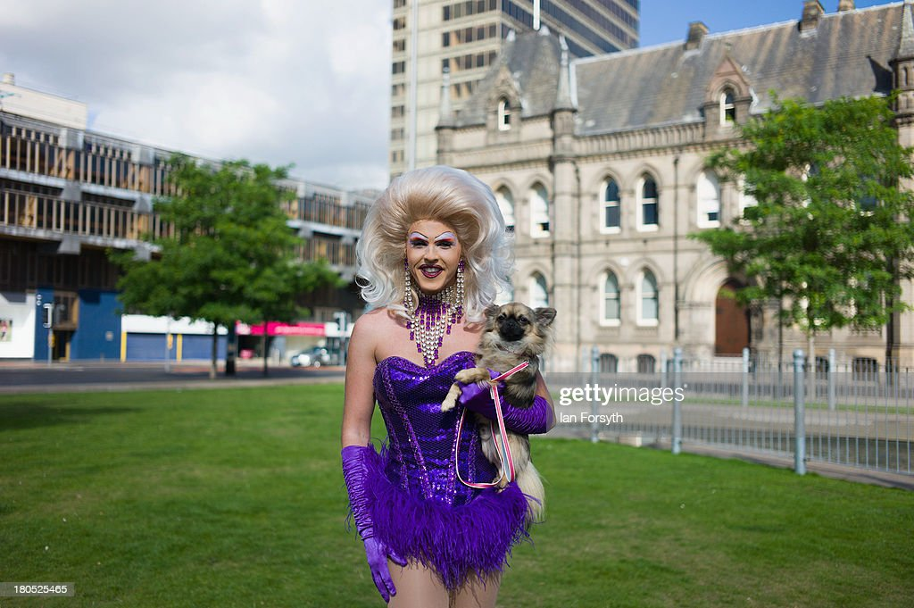 Miss Tess Tickle and her dog 'Beau' pose at the start of a parade during a Community Pride event on September 14, 2013 in Middlesbrough, England. The parade was the culmination of a three day event to raise awareness and celebrate Lesbian, Gay, Bi-sexual and Transgender life.