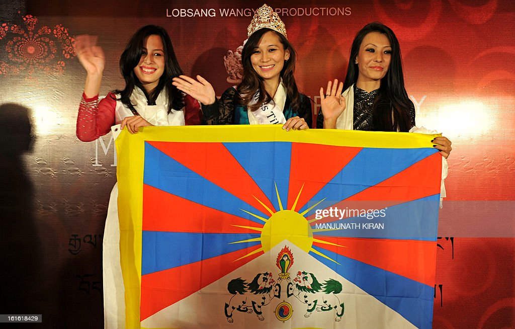 Miss Tibet 2013 Tenzing Lhamo (C) flanked by outgoing Miss Tibet Tenzin Yangkyi (L) and Miss Tibet 2007 Tenzin Dolma (R) pose for photographers during the coronation ceremony held in Bangalore on February 13, 2013. Lhamo was the lone contestant and was unanimously crowned with the Miss Tibet 2013 title. AFP PHOTO/Manjunath KIRAN
