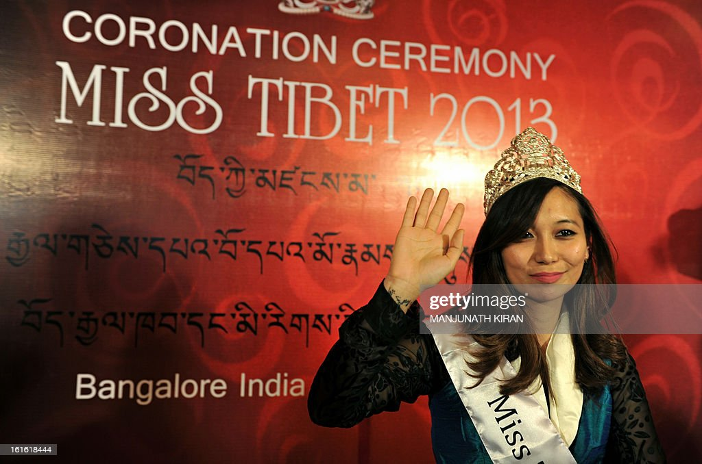 Miss Tibet 2013 Tenzing Lhamo waves during the coronation ceremony held in Bangalore on February 13, 2013. Lhamo was the lone contestant and was unanimously crowned with the Miss Tibet 2013 title. AFP PHOTO/Manjunath KIRAN