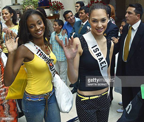 Miss Trinidad and Tobago Danielle Jones and Miss Israel Gal Gadot wave to photographers 29 May 2004 in Quito The Miss Universe 2004 contest will take...