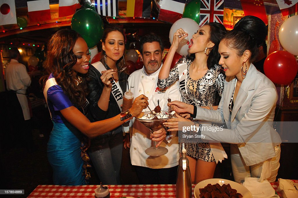 Miss Trinidad & Tobago Avionne Mark, Miss Turkey Cagil Ozge Ozkul, Chef Stuart Leitner, Miss Vietnam Luu Thi Diem Huong and Miss Thailand Nutpimon Farida Waller appear at the Buca di Beppo Italian Restaurant on December 6, 2012 in Las Vegas, Nevada.