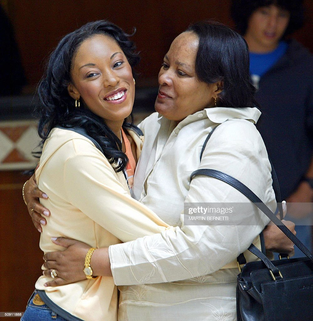 Miss Turks and Caicos Shamara Ariza (L) embraces her mother, 30 May, 2004, in Quito, Ecuador, where the Miss Universe 2004 contest will be held next 01 June. AFP PHOTO/Martin BERNETTI