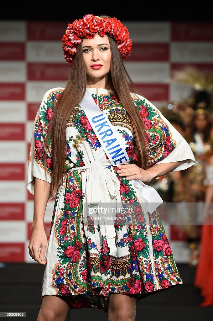 Miss ukraine iana ravlikovska parades during the national for Miss tattoo pageant