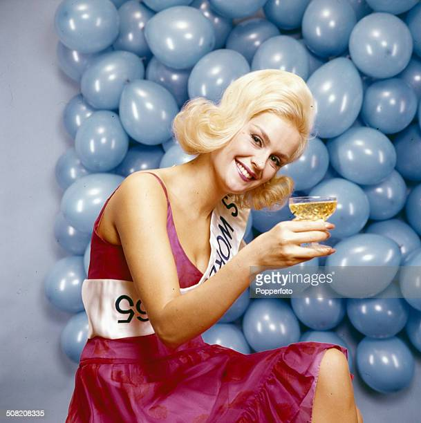 Miss United Kingdom and Miss World Lesley Langley posed holding a glass of sparkling wine in 1965