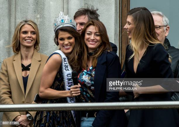 Miss Univers French Iris Mittenaere reacts next to miss France 2015 Camille Cerf next to head of the Miss France society Sylvie Tellier during her...
