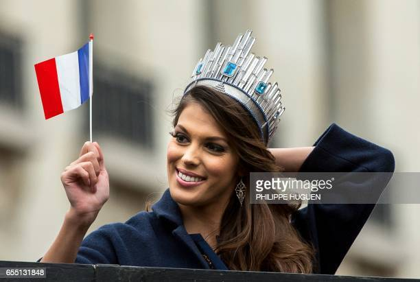 Miss Univers French Iris Mittenaere waves a French national flag as she salutes the crowd upon her arrival to visit Lille northern France on March 19...
