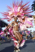 Miss Universe 1998 Wendy Fitzwilliam dances and poses for a photo during the Carnival Parade at the Trinidad Carnival on March 04 2014 in Port of...
