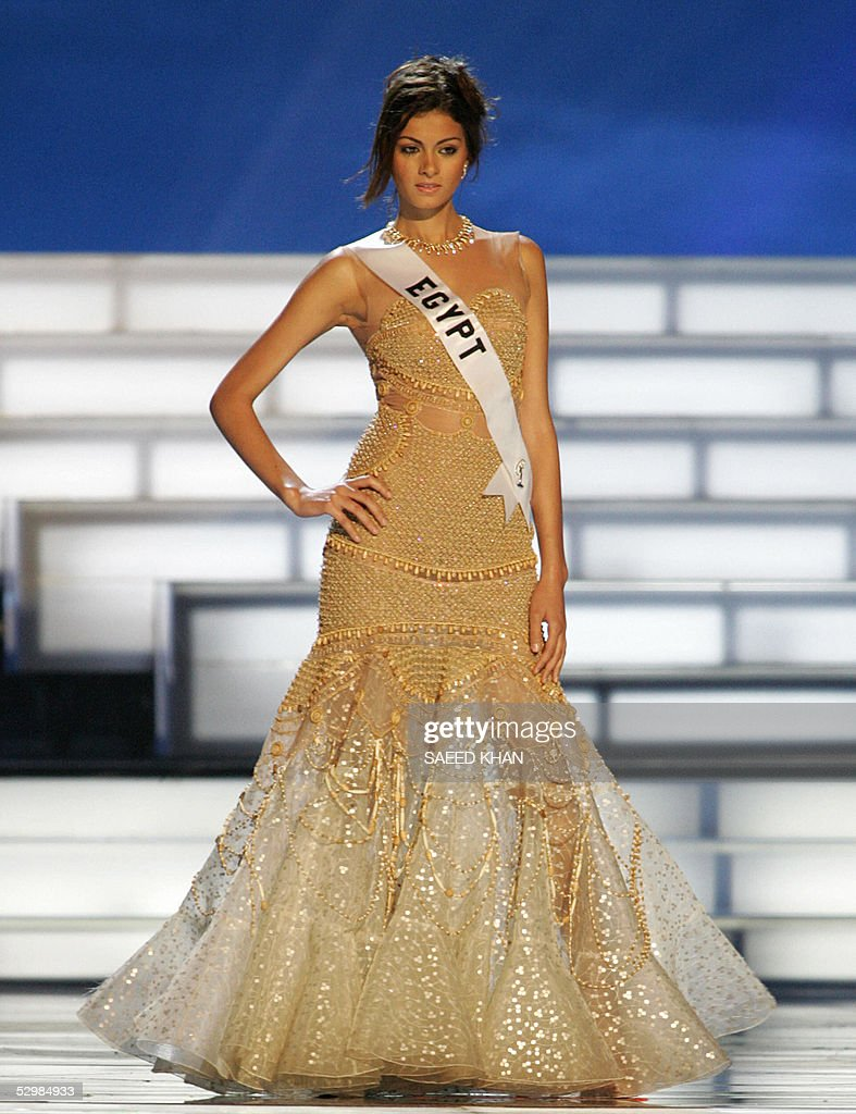Miss Universe 2005 contestant Meriam George of Egypt presents evening gown during the first round of judging in the swimwear and evening gown competition in Bangkok, 26 May 2005. The reigning Miss Universe, Jennifer Hawkins from Australia, will crown her successor in Bangkok before thousands of journalists and spectators on May 31. AFP PHOTO/ SAEED KHAN