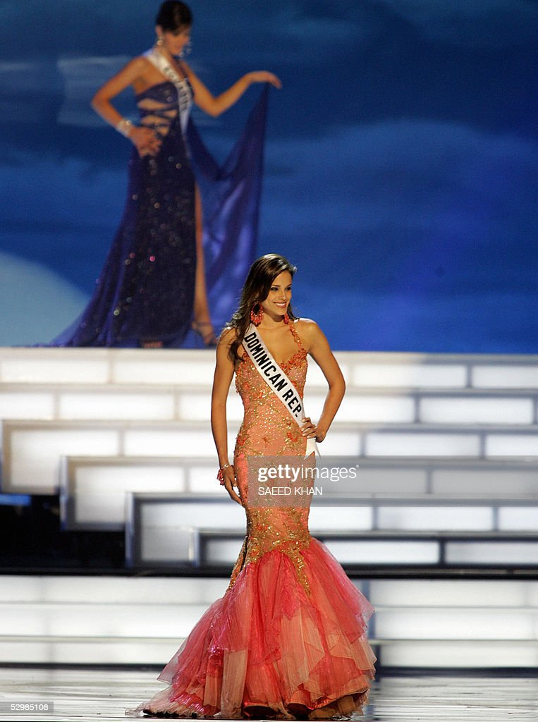Miss Universe 2005 contestant Miss Dominican Republic, Renata Sone, poses for photographs during the first round of judging in the swimwear and evening gown competition in Bangkok, 26 May 2005. The reigning Miss Universe, Jennifer Hawkins from Australia, will crown her successor in Bangkok before thousands of journalists and spectators on May 31. AFP PHOTO/ SAEED KHAN